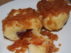Plum stuffed gnocchi with breadcrumbs and sugar