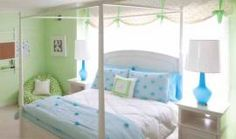 First Place: Interiors // Children's Room // Tracy Garfield Interiors This bedroom, created for pre-teen feminine sensibilities, is designed to grow with the girl. Soft lime-greens and bright blues add spunk and personality. The focal-point classic four-poster bed is flanked by bold ceramic blue lamps. A gathered window valance is done in a small-scale polka-dot print, a pattern that's repeated throughout the room.