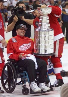 Steve Yzerman - In 1998, after formally accepting the Stanley Cup as the Captain of the Red Wings, immediately hands Vladimir Konstantinov the Cup having not been able to play after a horrific car accident.