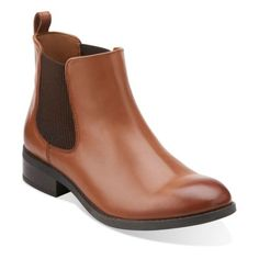 The classic Chelsea boot, crafted by Clarks® Artisan of rich black leather, features stretch panels and pull tab. Soft synthetic linings, OrthoLite® cushioned footbed, and grippy rubber outsoles provide updated comfort. This fashionable women's boot is easy to slip on with tights and a skirt, or with pants and jeans of all cuts and styles.