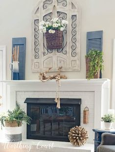 Painted brick fireplace decorated for summer worthing court. Fireplace Decor Summer, Summer Mantel, Chimney Decor, Summer Centerpieces, Diy House Projects, Brick Fireplace, Paint Furniture, Living Room Decor, Diy Home Decor