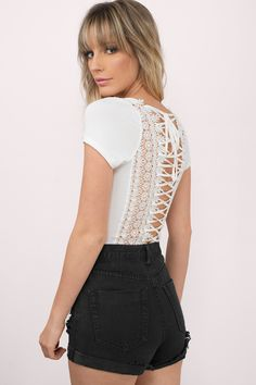 This might appear like a plain white tee in the front, but the back is held together by a string laced up and tied at the top. The back features a flo - Fast & Free Shipping For Orders over $50 - Free Returns within 30 days!