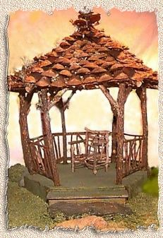 fairy gazebo roofed with pinecones