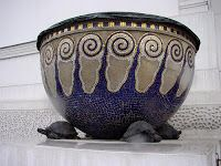 Large blue and gold planters designed by Koloman Moser that bracket the main entrance of the Secession Building in Vienna