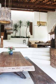 Sleek white and wood, open space, split level, steps, living room.| Shop: http://www.ohgoodgoods.tumblr.com Instagram…