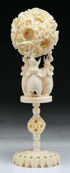 "A Chinese Antique Ivory Carved Puzzle Ball With Stand  Dimensions: H: 8-1/2""; (ball) D: 3"