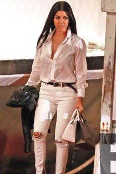 Kourtney Kardashian wearing Givenchy Small Antigona Tote, Balenciaga Classic Biker Jacket, Gianvito Rossi Plexi Pumps and Saint Laurent Westerns Hip Belt