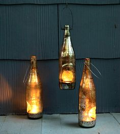 Repurposed beer bottle lanterns. Awesome! -D