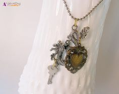 Dragon silver dragon heart bronze heart by APlusJewelryCrafts