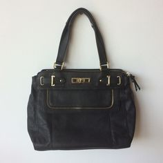 Olivia + Joy black satchel handbag Olivia + Joy satchel handbag. 100% pvc (not real leather) with 100% polyester lining. Gold tone hardware. Zip top closure. Strap drop length is approximately 8 1/2 inches. 13 L X 11 H X 4 W. All measurements are approximate. Olivia + Joy Bags Satchels