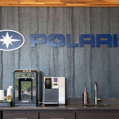 POLARIS HANGAR EDEN PRAIRIE, MN  Architect: Mid Minnesota Builders Finish: Frozen Titanium (blackened steel) Material: 0.8mm Industry: Transportation Photographer: Phalanx Studios