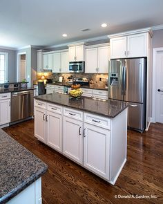 This #kitchen island provides extra counter space and #storage. The Weatherford - Plan 1053. http://www.dongardner.com/house-plan/1053/the-weatherford. #DreamHome
