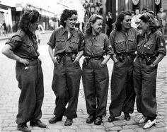FRANCE 16 August, 1944 -- These women are members of the FFI (French Forces of the Interior). They acted as guides and scouts - and assisted in mopping up German activity in captured French towns. Their uniforms show the French flag with the Cross of Lorraine, emblem of the Free French.