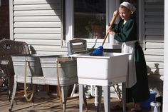 Is she doing laundry? Amish ways fascinate me, but I think i'd hate that.