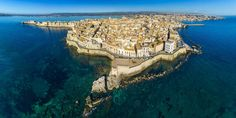 Syracuse Isola di Ortigia Coast of Ortigia island at the city of Syracuse, Sicily, Italy Syracuse's charms will sneak up on you. Alight from the train or bus Postcards From Italy, Norman Castle, Picture Postcards, Sicily Italy, Santa Lucia, Medieval Town, World Heritage Sites, Oahu, Day Trips
