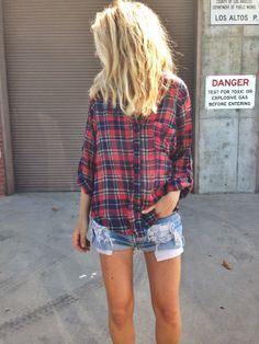 Define grungy casual. Pair a plaid polo to a ragged, almost faded denim shorts and voila!  Best with leather boots.