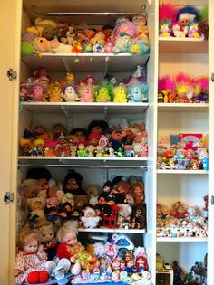 80s Toy cupboard... If I was dis organized as a child, this wld be my closet LOL !