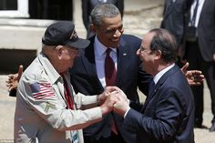 Together in arms: Barack Obama and French President Francois Hollande smile next to vetera...