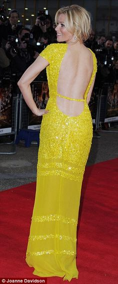 Mellow yellow: Elizabeth Banks wore a yellow backless Bill Blass dress at the London premiere of Hunger Games today.
