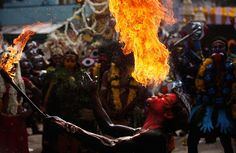 Hyderabad, India: an Indian artist performs with fire during a procession at the Bonalu festival, a Hindu folk festival in the Telangana region