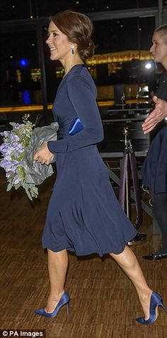 Simple and classic: Princess Mary chose to wear the Issa silk wrap dress to an event last year