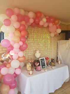 Rose gold and pink balloon installation