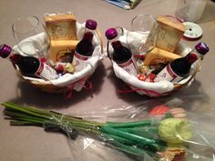 Baby Shower gift baskets I finally came up with... I used a basket, white bar towel, mini wine bottles, some good cheese, mini toasts, and some tasty chocolates, tied ribbon around wine glass and basket and ta-da!