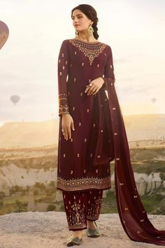 This Wine Satin Georgette Trouser Suit which will make all the goddesses of love and beauty to write you for your advice. Accompanied by Satin Georgette Trouser in Wine Color with matching Georgette Dupatta. Trouser has Resham, Zari and Stone work. Dupatta embroidered with Resham, Zari and Stone Work.