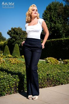 Laura Byrnes Wide Leg Trousers in Stretch Denim Our amazing High Waisted Trousers from Laura Byrnes California feature a high Empire waistline with a subtle curve that flatters every figure and elastic ruched panels on the back to allow for comfort and flexibility in movement, these denim trousers are completed with side slit pockets and a stitched inseam. To call these pants amazing is an understatement, and in this classic wide leg version, a marvel of casual-done-chic done right!