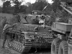 "A Panzer IV from 6. Kompanie/ SS-Panzer-Division ""Das Reich"" knocked out by M10 Wolverines in Normandy,France 1944."