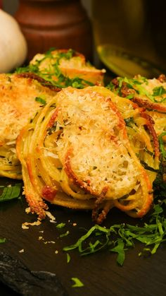 Recipe with video instructions: Get creative with your noodles and make something unexpectedly crispy and cheesy. Ingredients: ½ box (8 oz) spaghetti, 5 Tbsp heavy cream, 2 oz bacon, cubed, ½ bunch parsley, chopped, 1 clove of garlic, finely chopped, ½ cup grated Parmesan, 2 eggs, 4 tsp breadcrumbs