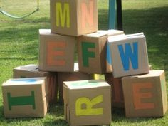 Letter Blocks, made from cardboard boxes and letter on each side. Fun outside play activity