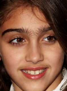 madonna's daughter, eyebrows, funny eyebrows,  disadvantage of dark hair... Mustache.. What age is appropriate for waxing ??