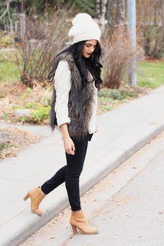 Ankle booties, black pants, and fur vest