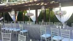 Head table with chandeliers, and back drop Chiffon Draping. Rentals by Platinum Event Rentals. Venue Japanese Friendship Gardens