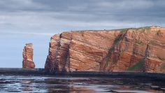 Helgoland - Germany. My first sailing trip was from Wilhelmshaven to Helgolamd. Nasty stormy. I was throwing up over the side of the boat with Geertje holding me by the ankles yelling in German 'put your finger down your throat'. Trip home was weather perfect.