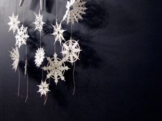 16 Dorm Decorating Ideas for the Winter Holidays : snowflakes on ribbon, maybe strung into white lights Christmas Love, Winter Christmas, All Things Christmas, Winter Holidays, Homemade Christmas, Christmas Ideas, Snowflake Garland, Paper Snowflakes, Christmas Snowflakes