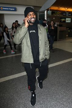 Kanye West wearing  Gosha Rubchinskiy x Dover Street Market Sweatpants, Yeezy Season 3 Invitation Jacket, Adidas Ultra Boost Shoes