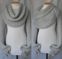 Scarf with sleeves at both ends in light grey.