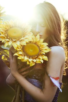 Photo of me and Lili with sunflowers from vdw house!