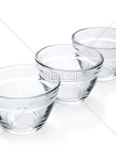 Three measuring cups. - Clear measuring cups with measuring markers on the side.