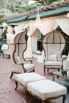 A-May-zingggg outdoor living space. Ohhh that furniture and chandelier and flowy white drapes!!! So pretty!!!