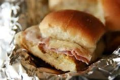 Hot ham & cheese sliders. Perfect superbowl food! 1 package Hawaiian Sweet Rolls, deli ham, Swiss or American cheese slices, and Dijon mustard.  Cut one roll in half, add slices of ham and cheese, add a squirt of dijon mustard and wrap entire sandwich in foil. Bake in oven at 350 degrees for about 15 minutes to create delicious, melty goodness.  Enjoy!
