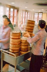Carts stacked high with dim sum baskets