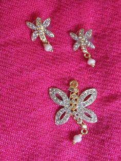 Butterfly shaped diamond earrings - Sweta Sutariya