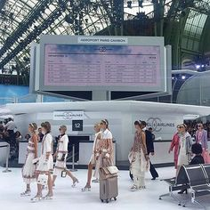 10 Things to Know About Chanel's Spring 2016 Show: For the occasion, Lagerfeld and co. transformed the Grand Palais into a mock airport terminal complete with baggage check, numbered gates, a departures and arrivals board (listing past Chanel destination show locales), and baggage carts stamped with double-C logos.