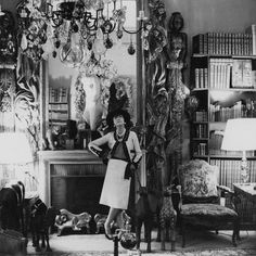 1965    Coco Chanel is standing in her Paris apartment at 31 rue Cambon.