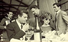 "Federico Fellini, Pier Paolo Pasolini, Marcello Mastroianni and Anouk Aimée on the set of ""La Dolce Vita"""