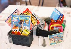 Children's Game Centerpieces at the kids table - 11 Ways To Keep Kids Busy At Your Wedding   TheKnot.com
