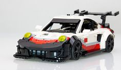 Porsche's brand new and eye-brow-raisingly mid-engined 2017 spec 911 RSR was nabbing 2nd place in the GTLM class of its maiden outing the Rolex 24 Hours of Daytona at about the same time Lego design